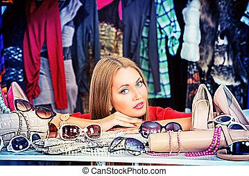 shopper - Fashionable girl shopping in a store.