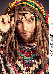 square glasses - Portrait of a happy rastafarian young man...