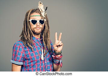 for peace - Portrait of a hippie young man in spectacles