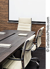 conference table with the screen