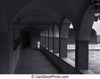 monastery peacefulness - a monk walking alone in the...
