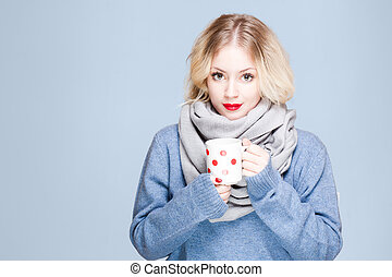 Warm up. - Portrait of blond beauty in winter clothes...