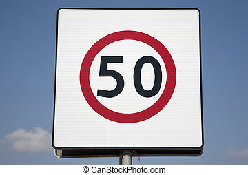 Fifty Speed Limit Sign on Blue Sky Background