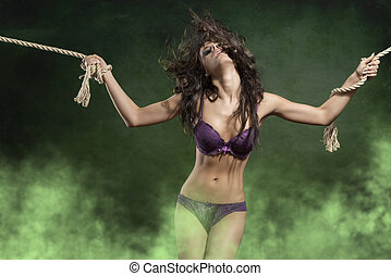 woman in lingerie tied by rope - cute portrait of very...