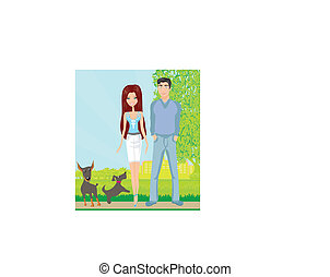 couple on a walk with the dogs