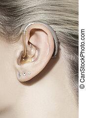 Beautiful woman ear hearing aid - Beautiful woman ear with...
