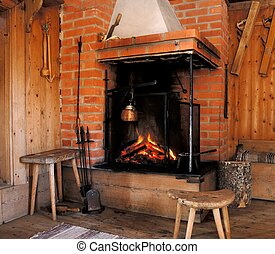 Log Cabin Fireplace - Wood fire in an old style wooden log...