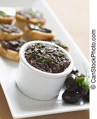 Black Tapenade on Toasts