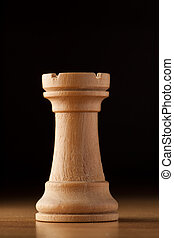 rook chess - photography of white rook chess on wood table