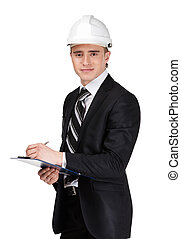 Male builder in headpiece with papers