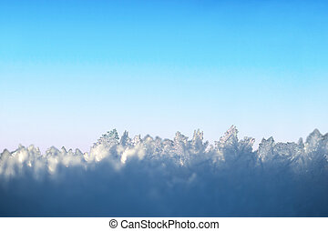 ice crystals on blue sky - Ice crystals on cold blue and...