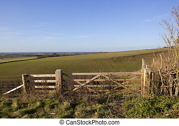 wolds gates - wooden farm gates overlooking cleaving coomb...