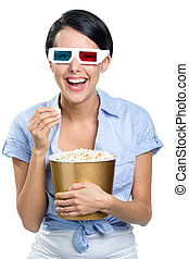 Girl watching 3D movie with popcorn - Girl watching 3D movie...