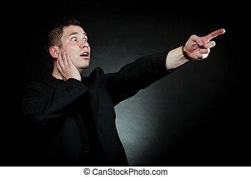 man pointing at something interesting - Surprised man...