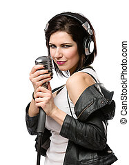 Rock musician with microphone and headphones