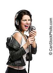 Rock singer with mic and headphones