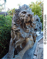 black natural stone Roaring lions on Display - HONOLULU, HI...