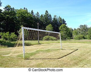 Soccer Goal with net in grassy field in Maine.