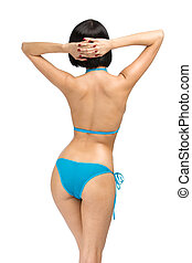 Backview of woman wearing bikini, isolated on white. Concept...