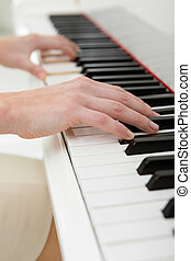Close-up view of hands playing piano - Close up of hands...