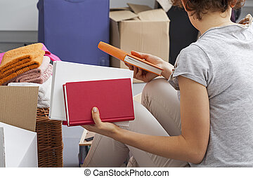 Moving to new apartament - Young woman moving out to new...