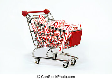 candy canes in shopping cart - Christmas candy canes in...