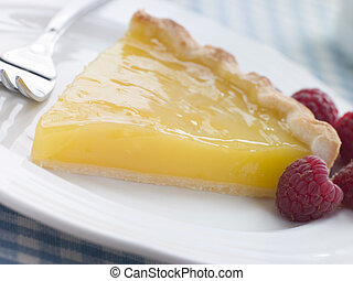 Slice of Lemon Curd Tart with English Raspberries