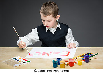 Little boy drawing energy formula - Portrait of little boy...