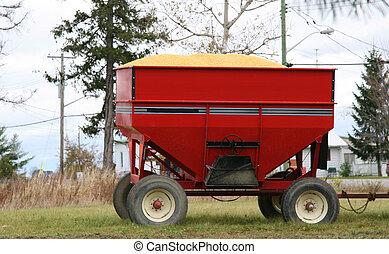 Corn harvest in tractor trailer bin - Corn harvest in red...