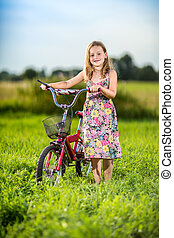 Young girl riding bicycle in a park