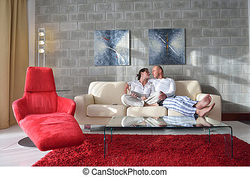 young couple using tablet computer at home
