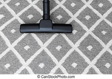 Vacuum cleaner on gray carpet - Housework. Vacuum cleaner on...