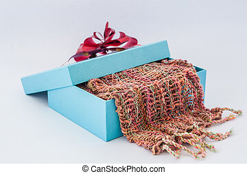 blue gift box with red ribbon and Striped scarf on isolated...