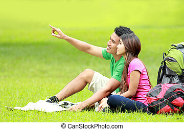 young couple camping in the park