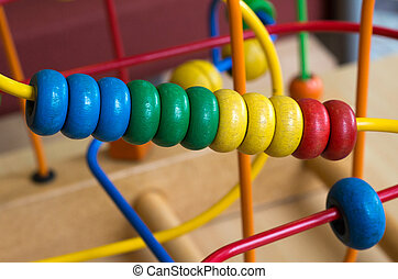 Wooden toy of colorful rings, close up.