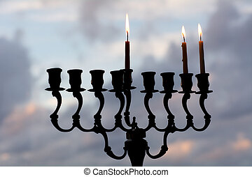 Hanukkah menorah on the second day of Hanukkah - Hanukkah...