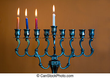 Hanukkah menorah on the third day of Hanukkah - Hanukkah...