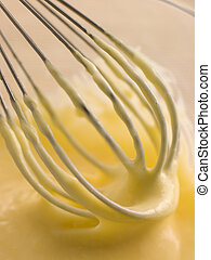 Hollandaise Sauce being whisked