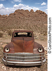 Old Rusted Out Car in the Desert Landscape