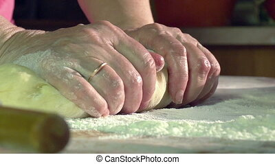 Kneading Dough - Slow Motion at a rate of 240 fps. Women's...