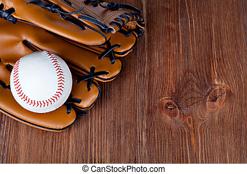 Baseball glove - Baseball and mitt on rustic wooden...