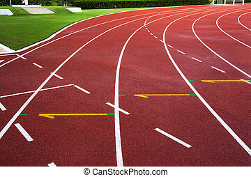 New running track with green grass abstract, texture, background.