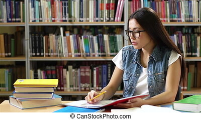 Library Learner - Charming student reading books and making...