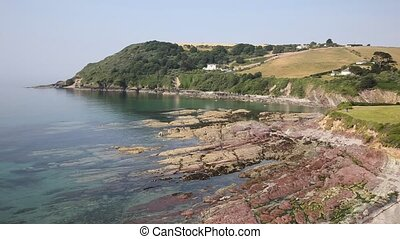 Talland Bay red rocks Cornwall - Talland Bay shingle beach...