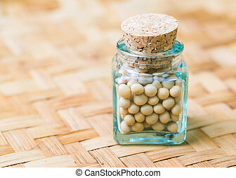 Soya bean in a small corked bottle