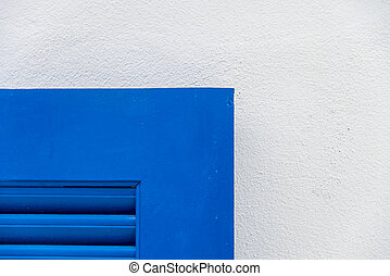 Edge of blue wooden window with white wall3