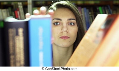 Looking For Book - Close-up of a student looking for a book...