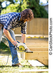 Carpenter Using Circular Saw - Carpenter using circular saw...