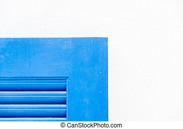 Edge of blue wooden window with white wall2