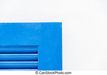 Edge of blue wooden window with white wall1